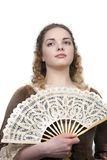 Beleza com o ventilador no vestido medieval Foto de Stock