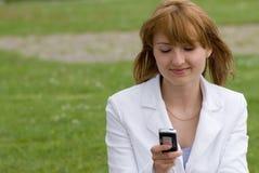 Beleza e o telefone Imagem de Stock