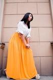 Beleza na saia amarela Imagem de Stock Royalty Free