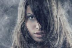 Beleza no fumo Imagem de Stock