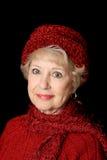 Beleza sênior no vermelho imagem de stock royalty free