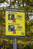 A Belfast City Council anti litter and dog fouling warning sign on display on the River Lagan Tow Path in South Belfast in Northe Stock Photos