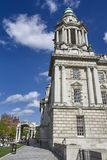 Belfast City Hall tower against blue cludy sky and white fluffy clouds. City hall Belfast against blue sky on a sunny irish day stock photo