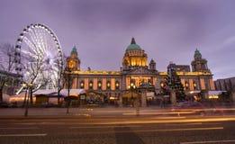 Belfast eye and city hall. Belfasts big eye and the city hall lit up at christmas Stock Photos