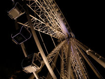 Belfast Eye by night. The large observation wheel in the grounds of Belfast City Hall, taken at night from close to the base Stock Photos