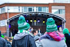 Women Wearing Green Hats Attend Live Concert in St Patrick`s Day at Belfast City. Belfast St Patrick`s Day Celebration 2018. Two Women Wearing Green Hats Attend Stock Photos