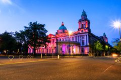 Nightlife with illuminated city hall in Belfast, UK Stock Image