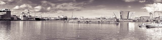 BELFAST, UNITED KINGDOM - AUGUST 24, 2016: Panoramic view of the Belfast`s harbor with the Titanic Museum Palace - toned image.  royalty free stock photography