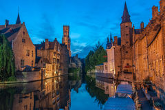 Belfort and the canals of Brugge in the evening Stock Photos