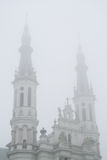 Belfries of the Church of the Holiest Saviour in Warsaw in mist. Belfries of the monumental Church of the Holiest Saviour in Warsaw , Poland, wreathed in mist Stock Photography