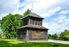 Belfry. Wooden two-slot belfry was built in 1868 pyramids with a roof, an octagonal tower surmounted and ornamental iron cross. In Lithuania Stock Image