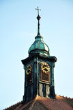 Belfry. Bell tower with a cross on the roof of the house Stock Photo