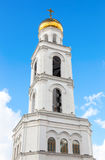 Belfry against the blue sky. Russian orthodox church Stock Photos