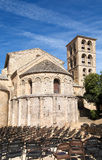 Belfry and apse. Apse and belfry of the church of Caunes-Minervois's Abbey with chairs prepared for a concert royalty free stock images