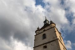 Belfry on the background of a cloudy blue sky. stock photos