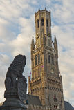 Belfry bell tower with lion statue in Bruges, Belgium Stock Photography