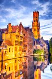 Belfry, Bruges, Belgium. Bruges, Belgium. Image with Rozenhoedkaai in Brugge, Dijver river canal twilight and Belfort Belfry tower Stock Photos