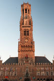 Belfry in Bruges in the evening. Belfry in Bruges lighted up by the setting sun in the evening Stock Photography