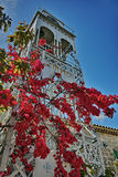 Belfry of the Church with Spring Flowers in Lefkada town Stock Images