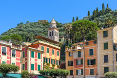 Belfry and colorful houses of Portofino. Stock Photos
