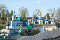 Belfry and domes of the assumption Cathedral of the Holy Dormition Pskovo-Pechersky monastery. Pechory, Pskov regi Stock Photos