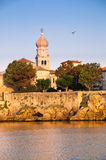 Belfry and old town walls by the sea at krk - Croatia Royalty Free Stock Images