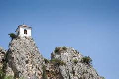 Belfry on the peak of the mountain Stock Photography