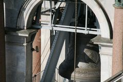 Belfry of the Saint Isaak Cathedral in Petersburg with the architecture details, walls, columns, arc window. The big bell with bas-relief of the Ekaterina the Stock Photo