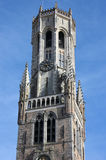 Belfry Tower in Bruges, Belgium. Detail of the Belfry Tower in Bruges, Belgium shot over clear blue sky Royalty Free Stock Photo