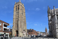 The belfry tower of the Church of Saint Eloi in Dunkirk, France. Dunkirk, France - May 31, 2017: Tourists walk around the belfry of the Church of Saint-Eloi Royalty Free Stock Photos