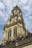 The belfry tower of the Gothic town hall in the French city Arras on a blue sky with white clouds background, World Heritage by UN. The Gothic town hall and its stock photography