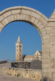 Belfry of the Trani cathedral seen through an arch Royalty Free Stock Photography