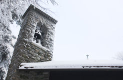 Belfry in the winter. Covered with snow Royalty Free Stock Photo