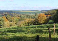 Belgian Ardennes. Beautiful autumn landscape of the Belgian Ardennes, with rolling hills, trees and green fields stock images