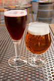 Belgian Beer. Styles with their own glasses on a table in a tavern Royalty Free Stock Images