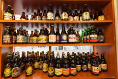 Belgian beer in a shop. GHENT, BELGIUM - AUG 23: Selection of traditional belgian beer in a small shop in Ghent. August 23, 2015 in Ghent, Belgium Royalty Free Stock Image