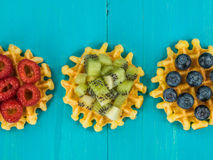 Belgian Butter Waffles With Blueberries Raspberries and Kiwi Fru Stock Image