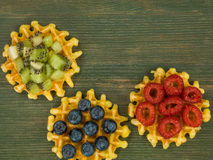 Belgian Butter Waffles With Blueberries Raspberries and Kiwi Fru Royalty Free Stock Images