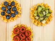 Belgian Butter Waffles With Blueberries Raspberries and Kiwi Fru Royalty Free Stock Photography