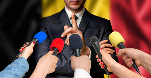Belgian candidate speaks to reporters - journalism concept Royalty Free Stock Photo