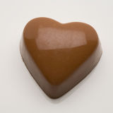 Belgian chocolate valentine heart. On a white background stock photos