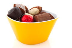 Belgian chocolate in yellow bowl Stock Photo