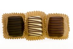 Belgian chocolates. On a white background Royalty Free Stock Images