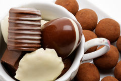 Belgian chocolates. In a cup royalty free stock photo