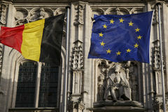Belgian and European flag and Charlemagne. Belgian and European flag on the City Hall in Mechelen, Belgium, in front of a statue of Charlemagne Stock Photography