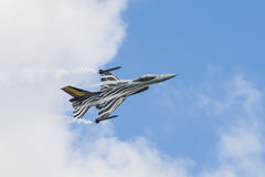 Belgian F-16 Fighting Falcon with smoke and condense stream Royalty Free Stock Photo