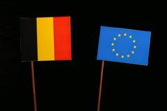Belgian flag with European Union EU flag isolated on black. Background Royalty Free Stock Photo