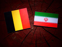 Belgian flag with Iranian flag on a tree stump isolated Stock Photography