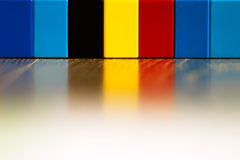 Belgian flag made of lego pieces with reflection Stock Photo