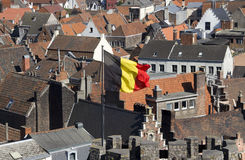 Belgian flag over Ghent Royalty Free Stock Photo